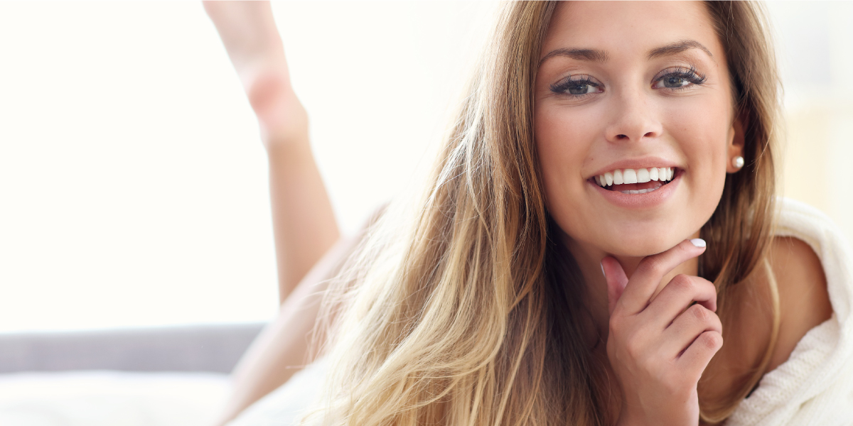 Keep youthful skin forever - beautiful young lady with a beautiful skin and smile.