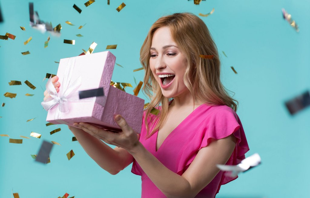 Register to win - woman opening gift