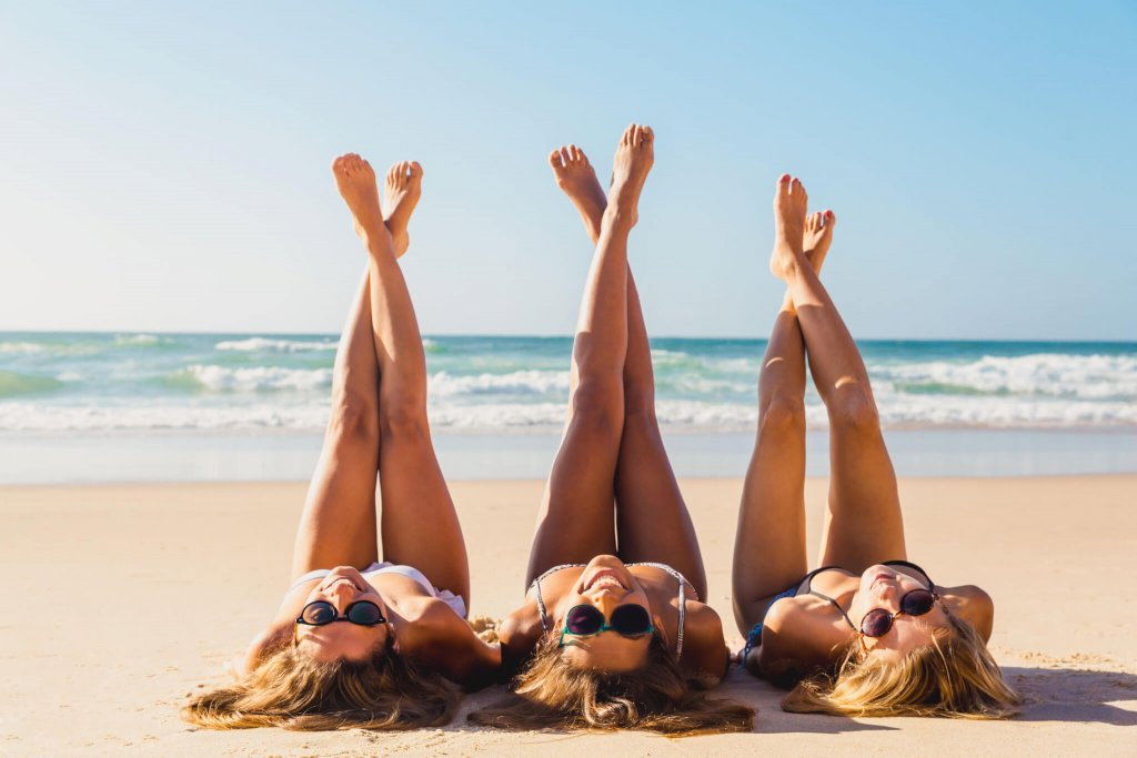 Pain-Free Laser Hair Removal showing girls on the beach